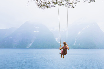 romantic beautiful girl on swing in Norway, happy dreamer, inspiration background