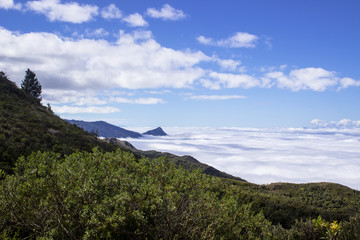 Looking down from above clouds on Mantiqueira mountain top in the resort town of Campos do Jordao, Brazil