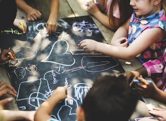 Diversity Group Of Kids Drawing Chalk Board