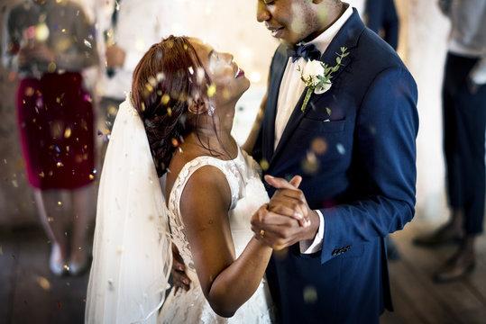 Newlywed African Descent Couple Dancing Wedding Celebration