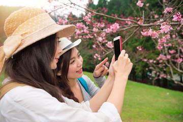 Travel asian girls using smartphone app