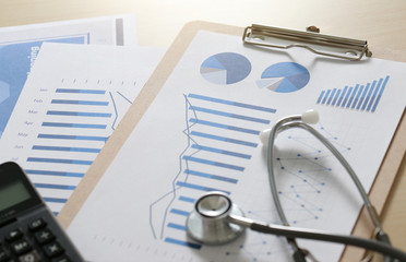 financial report chart and calculator Medical Report and stethoscope