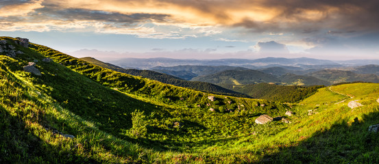 panorama of mountain ridge with peak at sunset