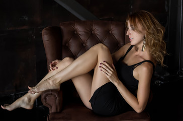 Beautiful young woman posing on couch
