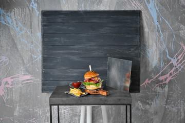 Tasty homemade burger on wooden table
