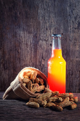 Boiled Peanuts and beer on wood background