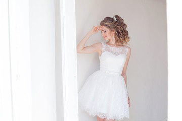 pretty girl in a short white wedding dress