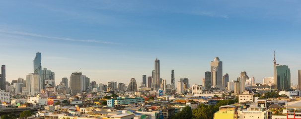 Panorama of cityscape buildings and skyscrapers of downtown luxury hotel with blue sky in bangkok thailand.