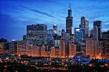 Wall Mural - Chicago lakefront skyline cityscape at night by millenium park with a dramatic cloudy sky.
