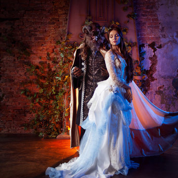 Fine art photo of beauty and beast. Beautiful girl and a monster, fairy tale, concept