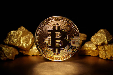Golden Bitcoin Coin and mound of gold