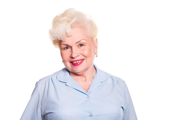 Elderly woman smiling on a white background, space for text