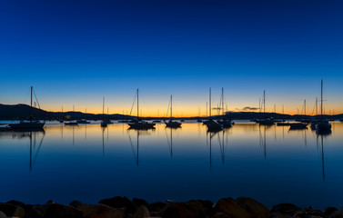 Daybreak waterscape over the bay with boats