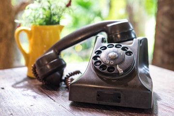 Old telephone on wooden desk