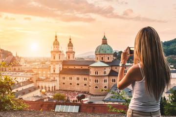 Tourist taking a photo of beatiful sunset in Salzburg Austria
