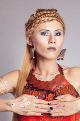 Young girl in ethnic dress of red color