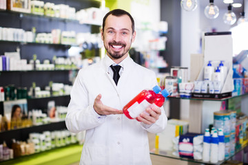 Male pharmacist in pharmacy