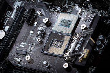 Modern computer processor on motherboard socket.