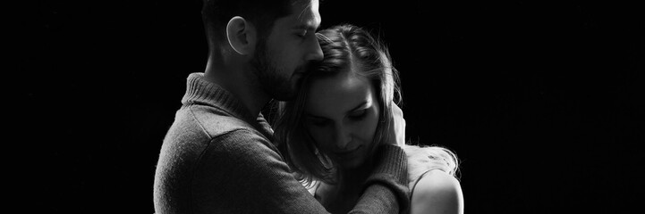 Panorama of loving couple embracing
