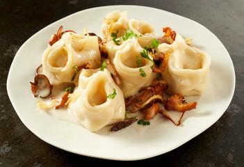 Handmade fresh manti pasta with mushrooms