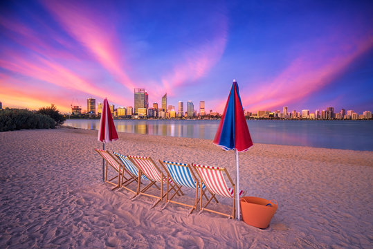 Deck chairs on a beach overlooking Perth City, Western Australia
