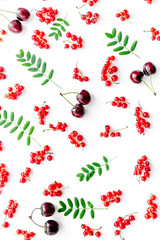 Berry pattern. Red currant, cherry and leaves on white background top view