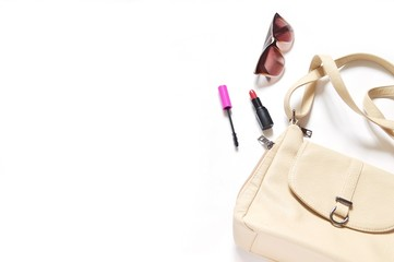 Flat lay fashion mockup/ Beige ladies bag, mascara, red lipstick and brown sunglasses. Style, image. Free space for text
