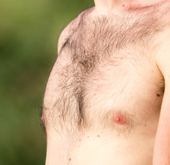 Hairy chest of a man in the open air