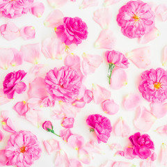 Floral pattern made of pink roses and petals on white background. Flat lay, top view