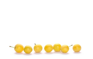 Wild plums with leaves and twigs, ringlov, isolated on white background