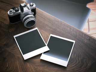 Camera and two blank photo frames. 3d rendering