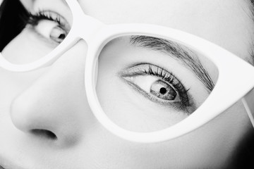 Image of a beautiful young woman wearing glasses. Wall mural