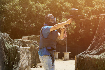 Guy with a paintball gun, extreme sports