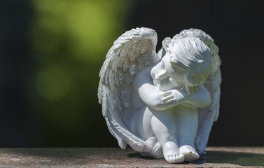 Child angel statue on gravestone