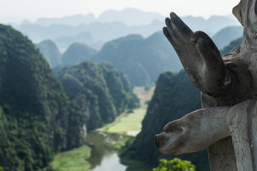 Limestone Landscape with Flooded Rice Paddies and Statue, Mua Caves Viewpoint, Tam Coc, Vietnam