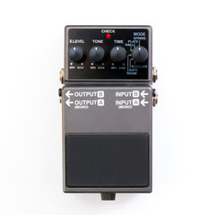 Guitar pedal. Top view of a guitar effect pedal on white background.