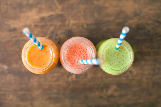Fresh Juices Smoothie Three Jar made Red Green Orange Fruits Water Melon Strawberry Apple Kiwi Grapes Pomegranate Passion Dragon Fruit Tropical Selective focus