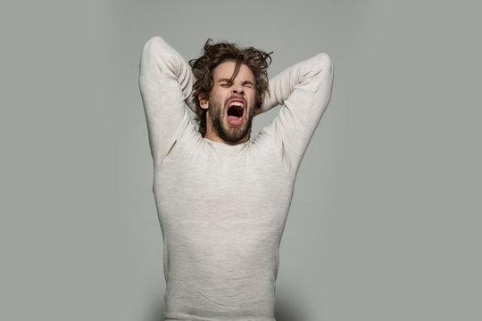 yawning man in morning