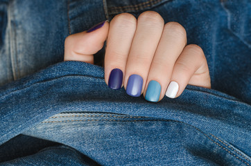 Blue nail design. Beautiful female hand with different shades of blue nail design.