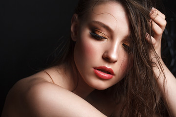 Beautiful young model with evening make up, perfect skin. Trendy golden eye-shadows