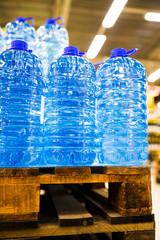 bottled still water on the palette