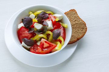 Delicious vegetable salad with feta cheese tomato and pepper