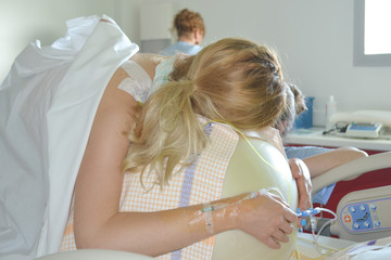 Woman during contractions on a fitness ball Parturition