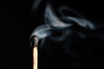 extinguished match liberally let smoke isolated on black background