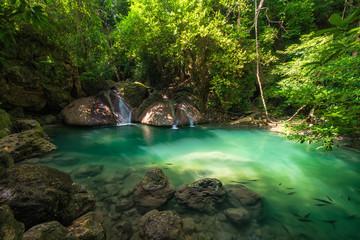 Green waterfall at deep forest, Erawan waterfall located Kanchanaburi Province, Thailand