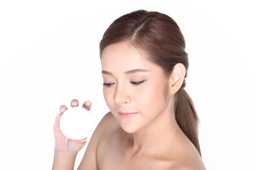 Young smiling female holding a white blank round jar bottle of Cosmetic skin care package product