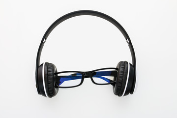 Headphones and glasses isolated on a white background