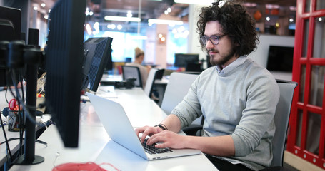businessman working using a laptop in startup office