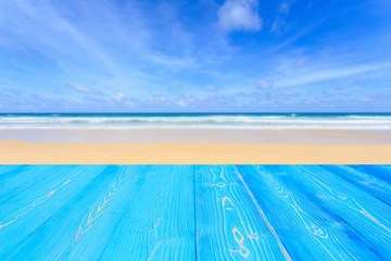 Top blue wooden table and view of tropical beach background. For display or product montage design