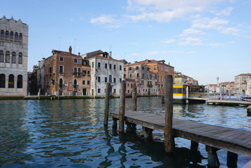 Public boat pier along the canal with beautiful builing around  in Venice